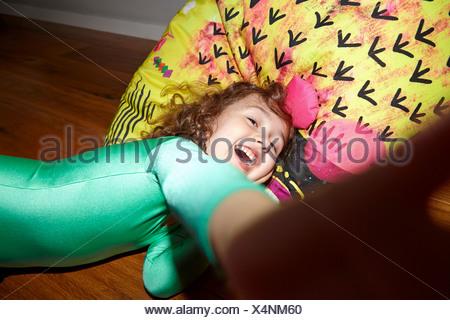 Child on bean bag on floor - Stock Photo