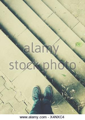 High Angle View Of Man Standing On Steps - Stock Photo