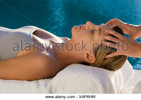 Young woman receiving facial massage - Stock Photo