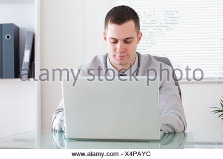 Businessman working on laptop - Stock Photo