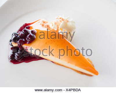 cheese cake with red fruits and whipped cream - Stock Photo