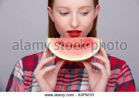 Young woman with slice of watermelon - Stock Photo
