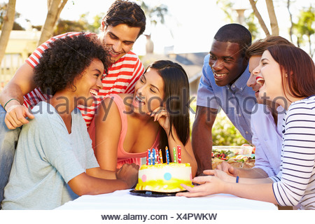 Group Of Friends Celebrating Birthday Outdoors - Stock Photo