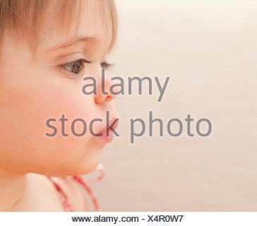 Profile of pensive baby girl - Stock Photo