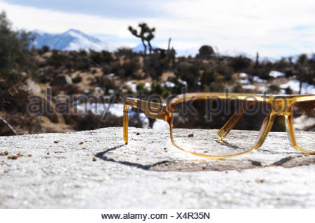 Stone, glasses, lie, forgotten view, scenery, blur, sunglasses, brown, yellow, stone, sunscreen, ocular protection, rack, bile, view, mountains, left, stored, holidays, vacation, travelling, Uv, Uv protection, sun themselves, sunny, - Stock Photo