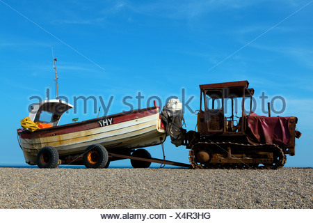 A boat and a tractor on a beach - Stock Photo