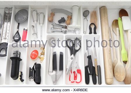 Utensils in kitchen drawer - Stock Photo