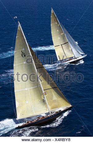 J-Class 'Velsheda' and the new replica of 'Ranger' (top) racing at Antigua Classic Yacht Regatta, Caribbean, 2004 - Stock Photo