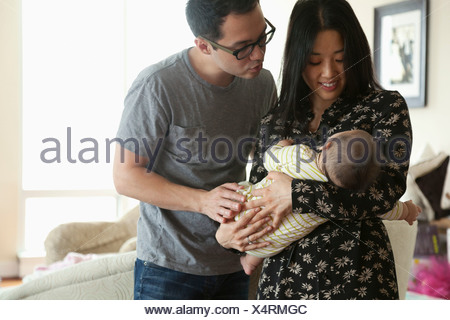 Parents holding baby girl - Stock Photo