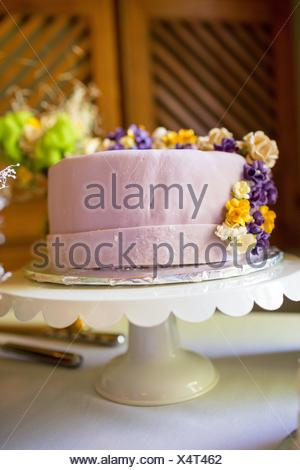 Whimsical wedding cake at a unique reception in Oregon. - Stock Photo