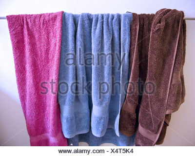 Close-up of three towels hanging on a clothesline - Stock Photo