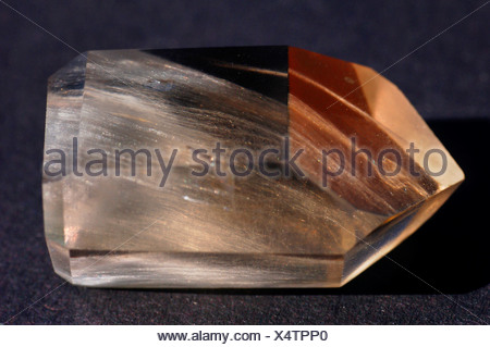 rock crystal with byssolite streaks - Stock Photo