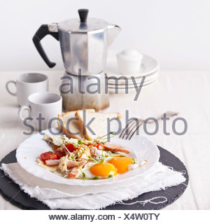 Ham and egg breakfast with toast, coffee and salad - Stock Photo