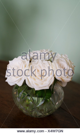 Roses in glass on table - Stock Photo