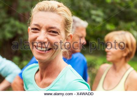 Portrait of mature woman, outdoors, smiling - Stock Photo