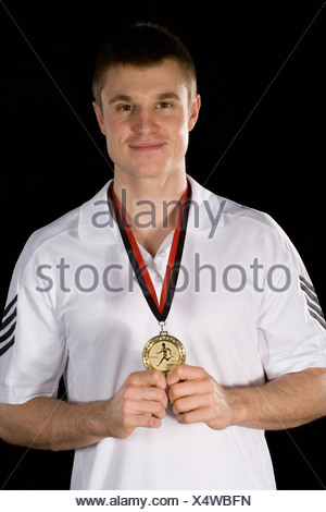 A sportsperson wearing a gold medal - Stock Photo
