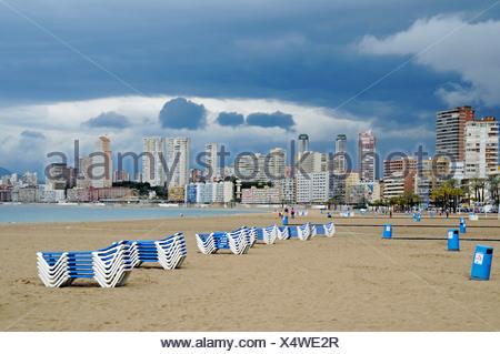 Empty beach, deck chairs, dark clouds, bad weather, crisis, Playa de Poniente, Ponent, beach, Benidorm, Costa Blanca, Alicante, - Stock Photo