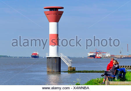 leading lights Buetzeflether Sand, container ship in background, Germany, Lower Saxony, Elbe, Stade - Stock Photo
