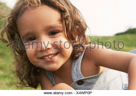 Portrait of young boy with brown hair, smiling - Stock Photo