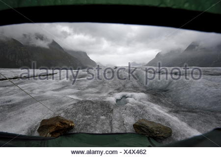 The view from inside my tent, looking out over the Aletschgletscher shortly after a storm had past by - Stock Photo