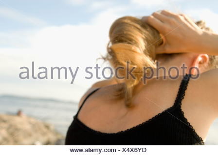 A woman in the archipelago, Sweden. - Stock Photo