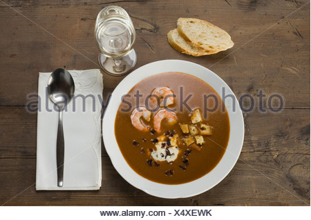 Fish soup, Soupe de Poisson, with shrimp, croutons and Dulse (Palmaria palmata), a red alga - Stock Photo