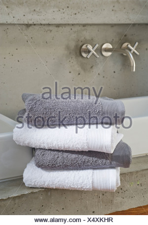 Towels in a contemporary styled bathroom - Stock Photo