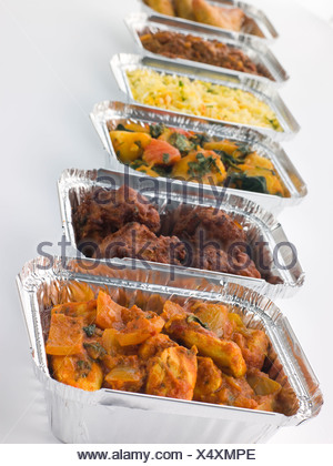 Selection Of Indian Take Away Dishes In Foil Containers - Stock Photo