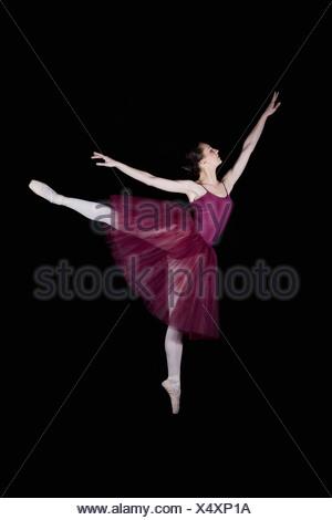 A ballet dancer doing an arabesque - Stock Photo
