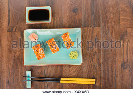 Sushi rolls on the wooden table. Overhead view - Stock Photo