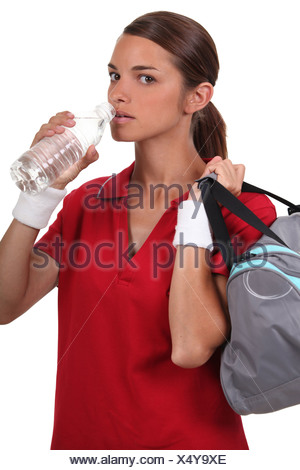 Woman drinking bottle water - Stock Photo