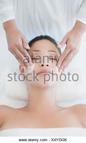 Woman receiving facial massage - Stock Photo