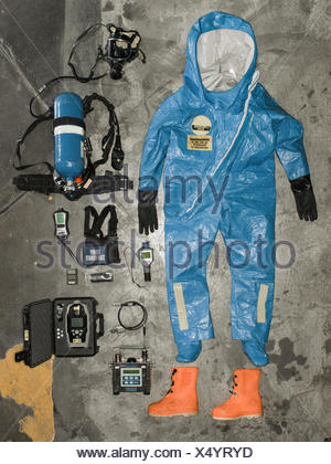Nuclear radiation suit and accessories hangs on the wall. - Stock Photo