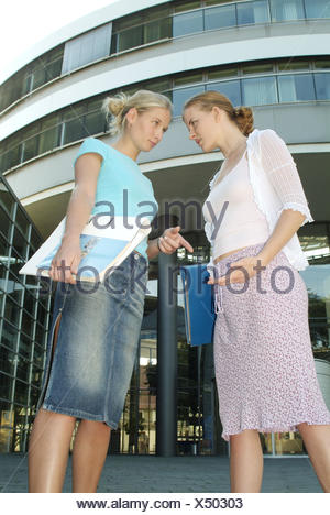 University, students, seriously, difference opinion, young persons, 20-30 years, schoolgirls, future, view, perspective, conclusion, graduation, ambition, self-confidence, career, Future-oriented, colleagues, friends, rivals, rivalry, jealousy, envy, figh - Stock Photo