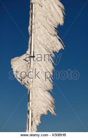 Ice-covered flagpole, Zugspitze Mountain, Bavaria, Germany, Europe - Stock Photo