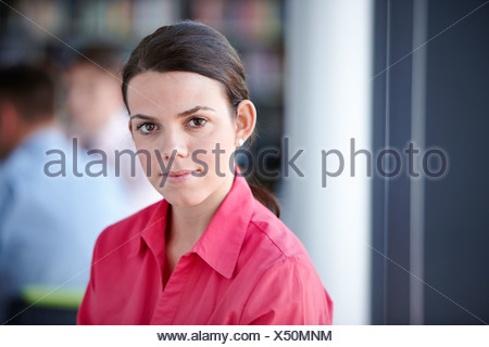 Portrait of businesswoman in red blouse - Stock Photo