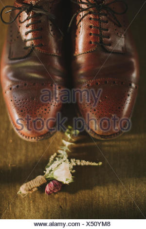 Stilllife, wedding, men's shoes, small bouquet - Stock Photo