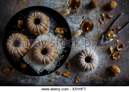 Subtly delicious plain cake with chestnut flour especially nice with walnuts. Set up on a vintage pan. - Stock Photo