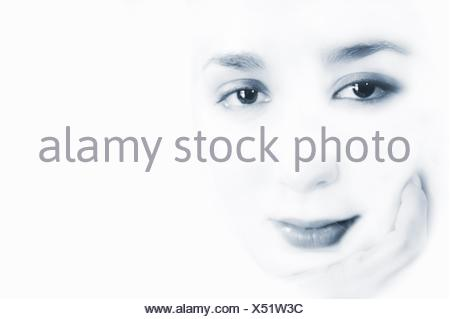 Black and White portrait of young woman looking at the camera in high key - Stock Photo