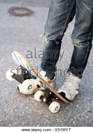 Closeup on person with skateboard - Stock Photo