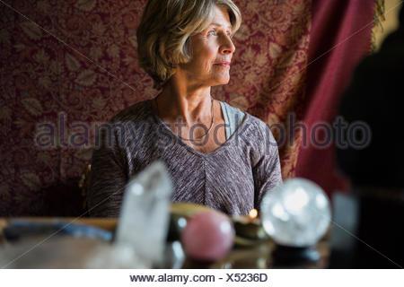 Pensive senior woman looking away - Stock Photo