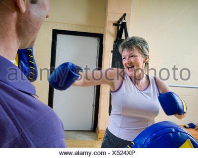 senior woman boxing exercise - Stock Photo