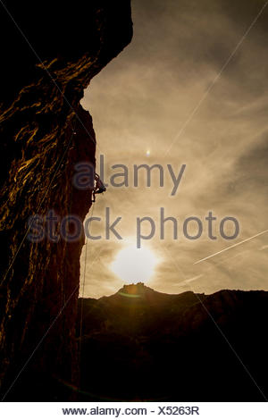 Man climbs Pretty in Pink at Echo Cliffs - Stock Photo