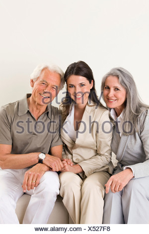 Portrait adult daughter with mother and father - Stock Photo
