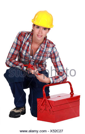Tradeswoman holding a wrench - Stock Photo