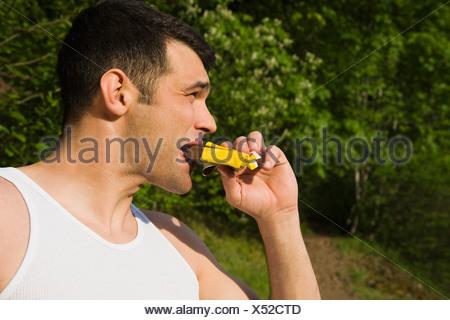 Man eating energy bar - Stock Photo