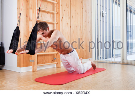Man during sling therapy - Stock Photo