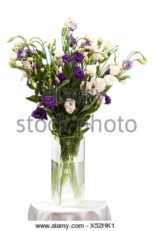 Bouquet Of Eustoma Flowers In Vases Isolated On White Stock Photo