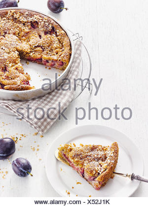 Plum cake with brittles - Stock Photo