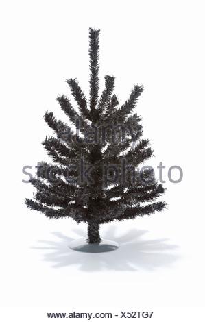 A small artificial Christmas tree - Stock Photo